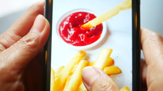 taking photo shot of french fries with mobile phone - photo manipulation stock videos and b-roll footage