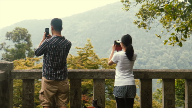 taking photos during hike (slow motion) - lypsekyo16 stock videos and b-roll footage
