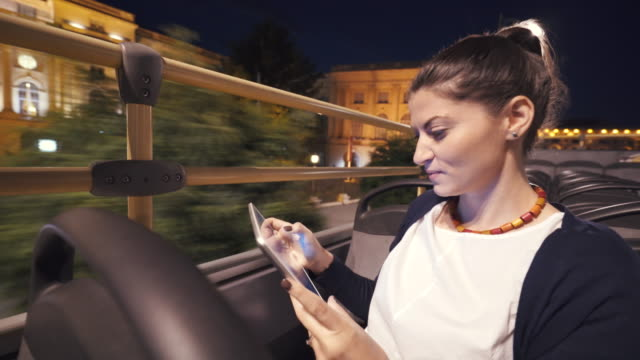 taking photos in a tour bus with a digital tablet. - autobus a due piani video stock e b–roll