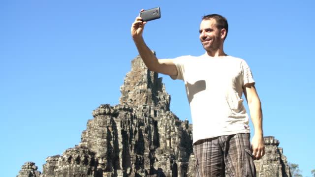 Taking photos in Angkor Wat