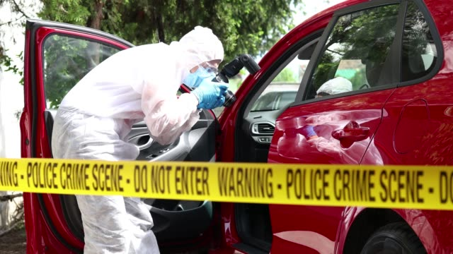 taking photos of a car - police crime scene - mystery stock videos & royalty-free footage