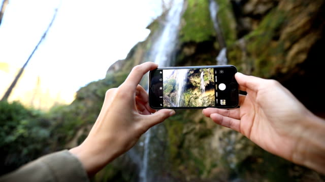 taking photos of waterfall - femininity photos stock videos & royalty-free footage