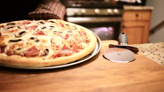 taking pizza out of the oven - pizza oven stock videos and b-roll footage