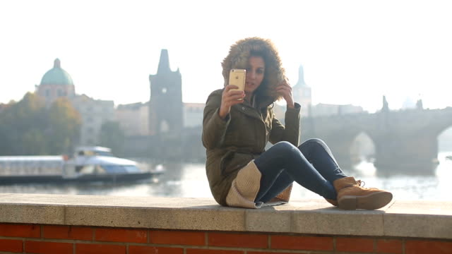 taking selfie by the vltava river - charles bridge stock videos and b-roll footage