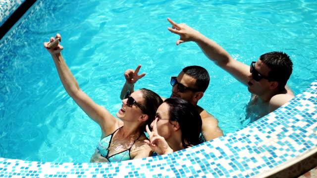 taking selfie in the pool - temi per la fotografia video stock e b–roll