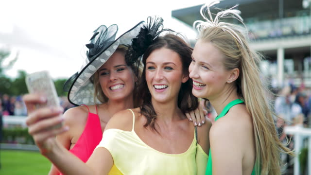 taking selfie on ladies day - horse racing stock videos & royalty-free footage