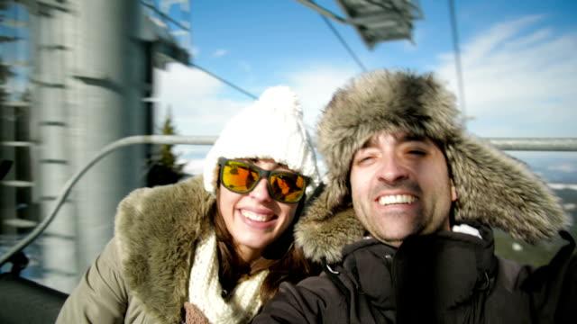 Taking selfie on ski lift