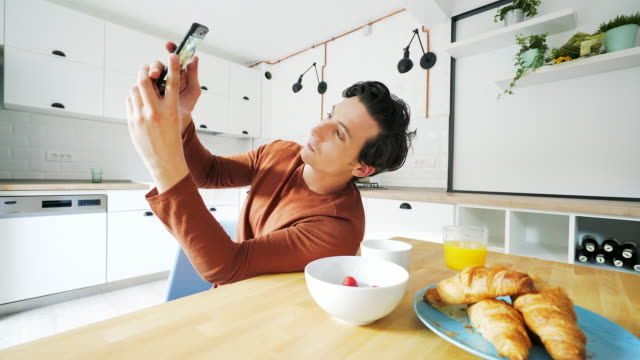 taking selfie with the breakfast. - photographing stock videos & royalty-free footage