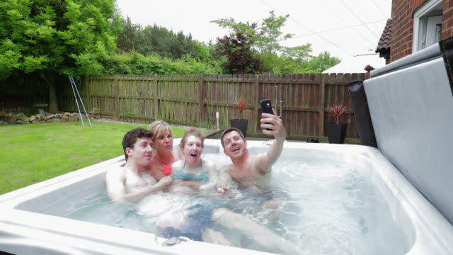 taking selfies in the hydrotherapy hot tub - scoliosis stock videos and b-roll footage