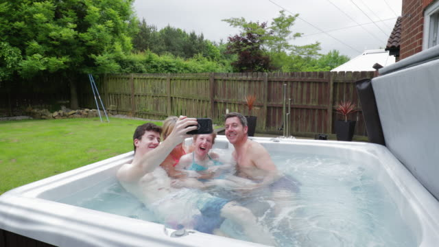 taking selfies in the hydrotherapy hot tub - sibling stock videos and b-roll footage