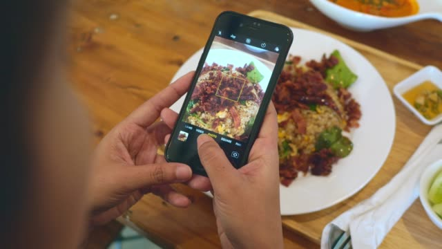 taking shot of thai food - photographing stock videos & royalty-free footage