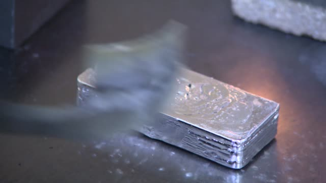 taking silver ingot out of form - silberfarbig stock-videos und b-roll-filmmaterial