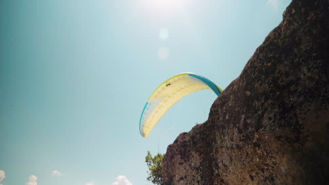 ws pov taking-off of a paragliding pilot seen from below, flying, cross country pilot, extreme sports, adventure - extreme sports point of view stock videos & royalty-free footage