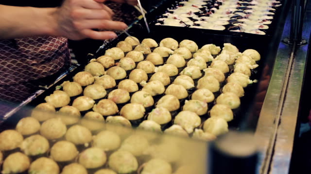 takoyaki is a kind of japanese food. - adulation stock videos & royalty-free footage