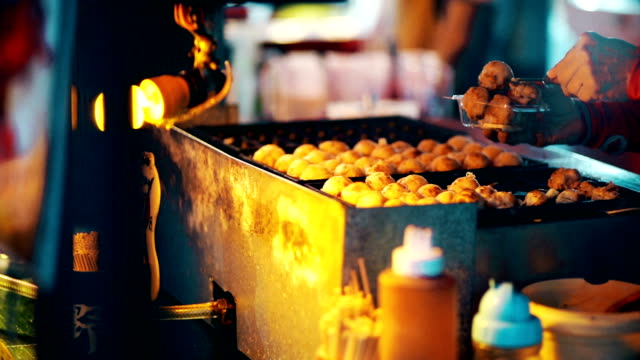 takoyaki on hot pan at the local market,thailand. - {{ contactusnotification.cta }} stock videos & royalty-free footage