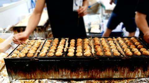 takoyaki recipe takoyaki - tokyo japan stock videos & royalty-free footage
