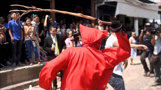 talcigüines men dressed as devils lash parishioners monday as part of an old holy week tradition to cleanse the sins of residents in texistepeque in... - holy week stock videos & royalty-free footage