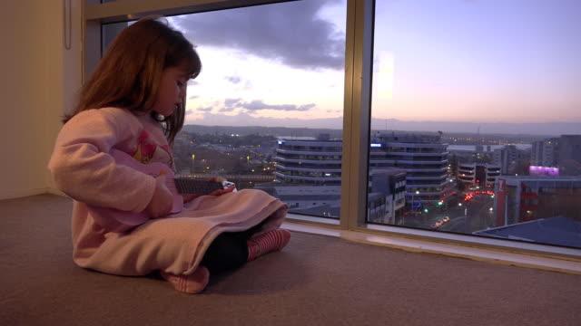 vídeos de stock, filmes e b-roll de talented young girl playing ukulele guitar - ukulele