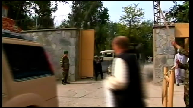 Taliban allegedly gun down ten Western aid workers Mortuary AFGHANISTAN Kabul EXT Afghan soldiers guarding the entrance to Kabul Military Hospital /...