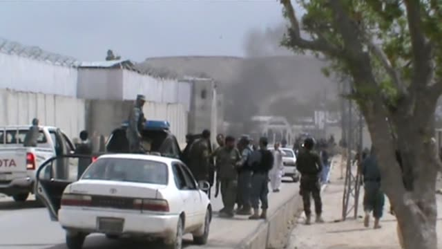 taliban car bomb struck a nato military convoy on saturday killing three foreign soldiers and two coalition civilian workers in the deadliest attack... - kabul video stock e b–roll