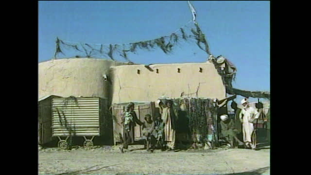"""taliban checkpoint decorated with destroyed cassette tape confiscated from passers by in kandahar, afghanistan; 2000. - """"bbc news"""" stock videos & royalty-free footage"""