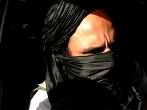 taliban fighters were retreating friday from a pakistan district where the government vowed to shore up a deal to enforce sharia law despite us... - peshawar stock videos & royalty-free footage