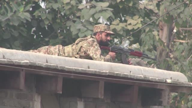 taliban gunmen storm an army run school in restive northwest pakistan killing at least 20 - taliban stock videos & royalty-free footage