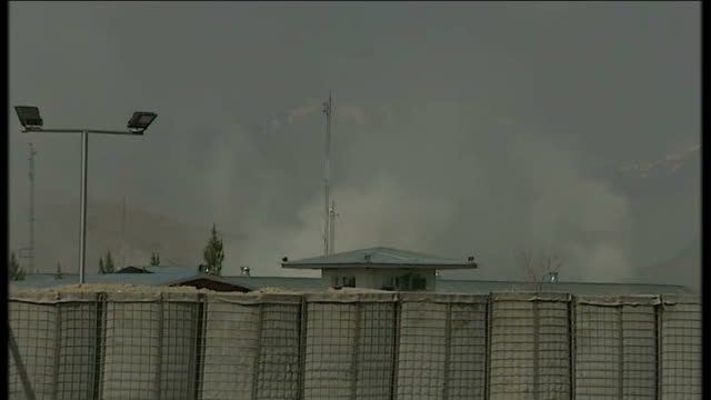 Taliban insurgents attack Election Commission HQ AFGHANISTAN Kabul Roof of Election Commission HQ glimpsed behind fence as explosion heard SOT