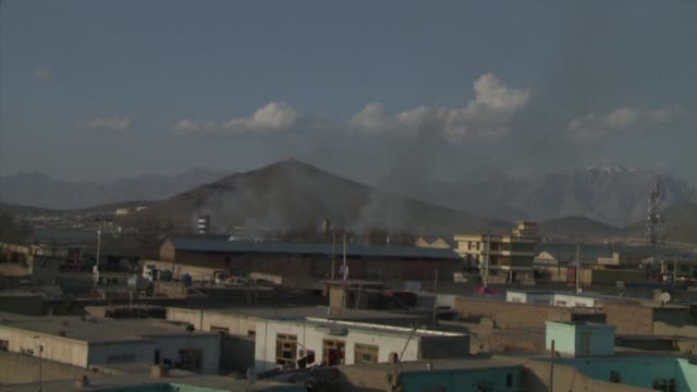 Taliban insurgents wearing burqas unleashed rockets and gunfire on the Afghan election commissions headquarters in Kabul on Saturday in the latest...