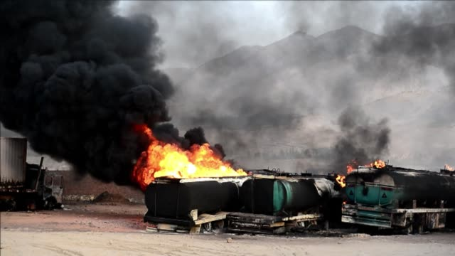 Taliban militants set fire to dozens of fuel trucks which they claimed were supplying foreign troops in Afghanistan in an attack on the outskirts of...