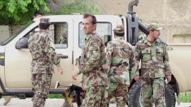 Taliban militants wearing Afghan army uniforms killed at least 50 soldiers in a gun and suicide attack at a base in northern Afghanistan the US...