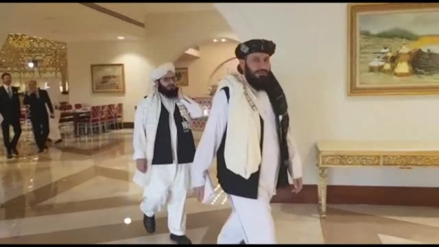 taliban negotiators arrive at the sheraton hotel in doha for the signing of the historic agreement with washington that paves the way for the... - afghanistan stock videos & royalty-free footage