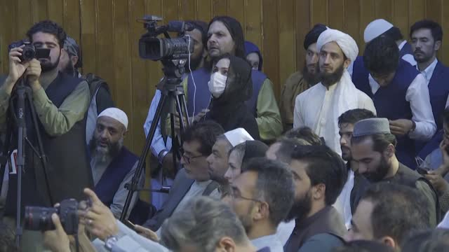taliban spokesman zabihullah mujahid speaks at afghan taliban's first press conference after taliban taking control of the capital city of kabul on... - press room stock videos & royalty-free footage