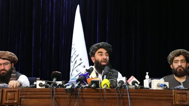 taliban spokesperson zabihullah mujahid answered press members questions as he held a press conference in afghanistan's capital kabul on tuesday. - press conference stock videos & royalty-free footage