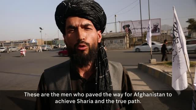 taliban takeover of afghanistan: 20 years since assassination of ahmad shah massoud; afghanistan: kabul: ext gv taliban fighters with guns monument... - crime and murder stock videos & royalty-free footage