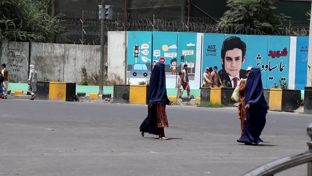 taliban takeover of afghanistan: fears over future of women's rights; afghanistan: kabul: ext gv two women wearing burkhas across road - women stock videos & royalty-free footage