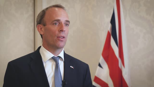 taliban takeover of afghanistan: uk prepared to talk to taliban leaders says dominic raab; qatar: doha: int dominic raab mp interview sot - [re... - corporate business stock videos & royalty-free footage