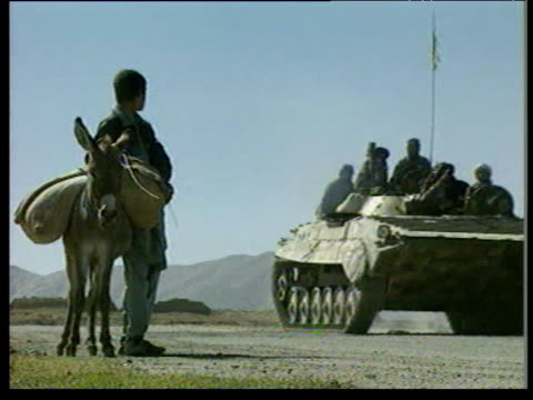 Taliban tank and jeeps along road during Afghan Civil War between pro government and Taliban forces Kabul Autumn 96