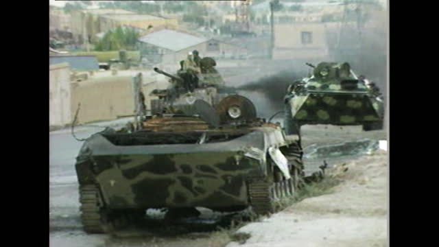 """taliban troops mounted on tanks travel through kabul, afghanistan; 1996. - """"bbc news"""" stock videos & royalty-free footage"""