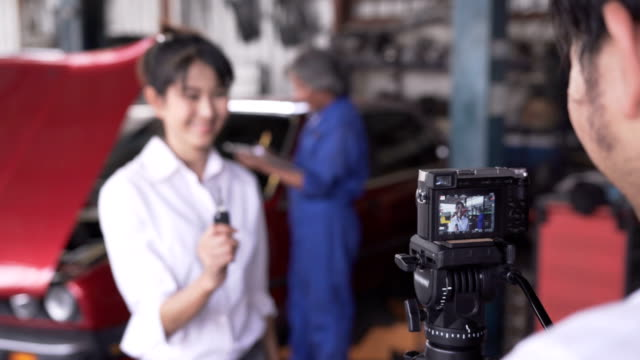 talking acttion og asian young female customer while using car repair service - cinematographer stock videos & royalty-free footage