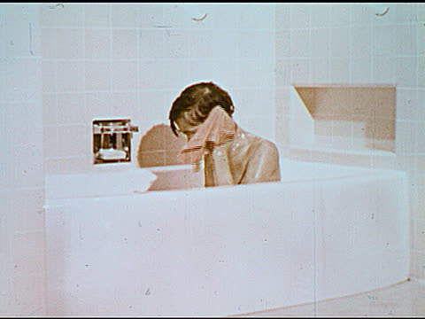 / talking bar of soap / boy bathing, washing with soap, then winks at camera. end title. - anno 1951 video stock e b–roll