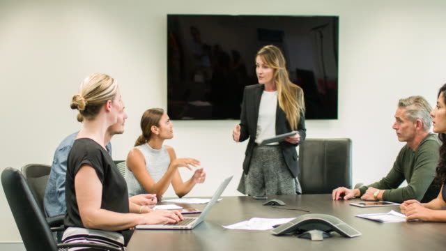 Talking in a meeting at the conference room