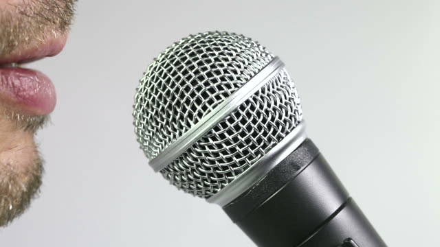 talking in microphone - weißer hintergrund stock videos & royalty-free footage
