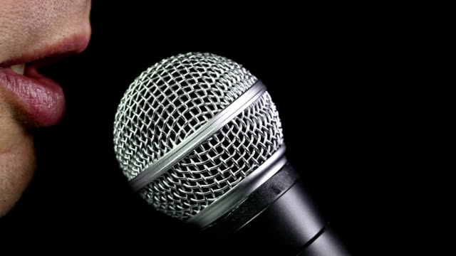 talking in microphone - microphone stock videos & royalty-free footage
