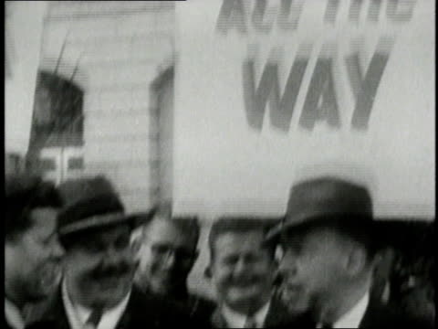 JFK talking in the street with supporters while campaigning in Wisconsin / Wisconsin United States