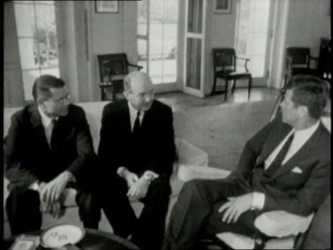 vídeos de stock e filmes b-roll de jfk talking to rusk and mcnamara about bay of pigs invasion / washington dc united states - 1961