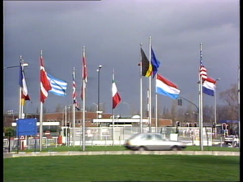 Talks BELGIUM Brussels F'back NATO flag flying amidst national flags large sculpture at NATO HQ