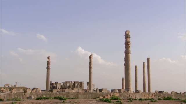 ws tall ancient columns rising above ruins of persepolis, persepolis, fars province, iran - iran stock videos and b-roll footage