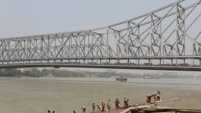 Tall bridge (Howrah bridge) over the holy river in Kolkata (City of Joy)