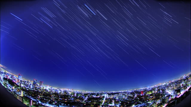Tall buildings and the star trajectory: SFX; Time Lapse.